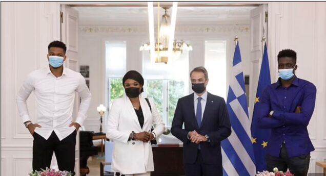 Greek Prime Minister Kyriakos Mitsotakis, 2nd left, with Giannis Antetokounmpo, his mum Veronica and son Emeka