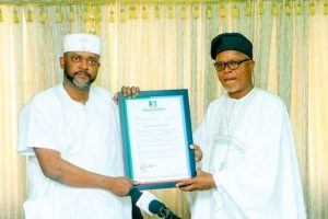 R-L: Dr Tom Ohikere, the Publisher APC Online News, presenting a Letter of Credence to Kogi Deputy Governor, Edward Onoja, on behalf of Gov. Yahaya Bello, on Friday in Lokoja.