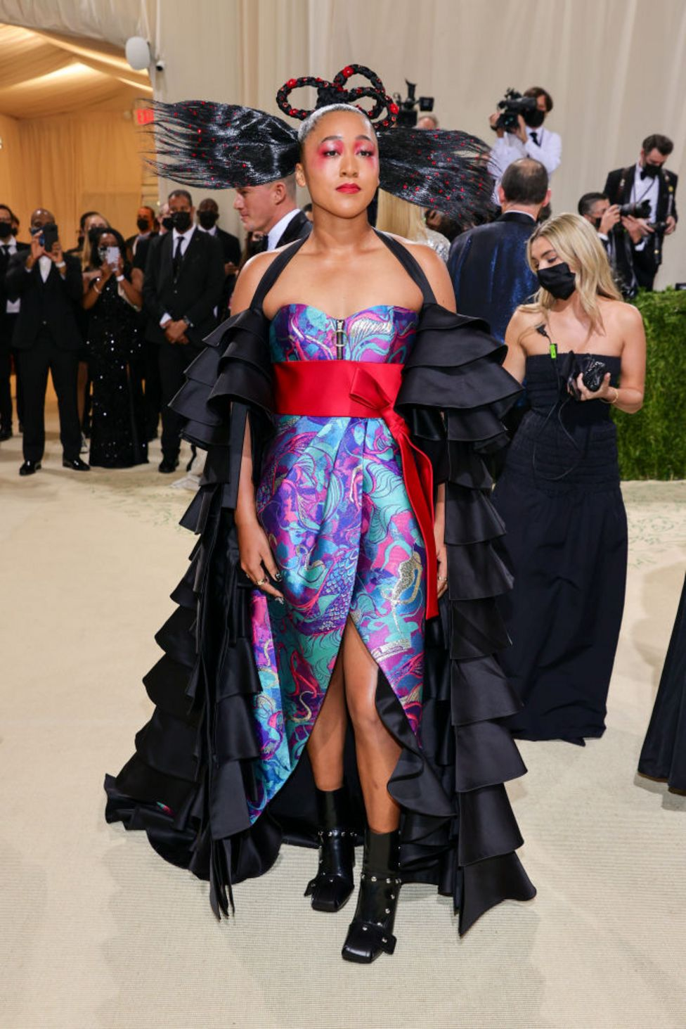 Co-host Naomi Osaka showed off a colourful Louis Vuitton dress and elaborate hairstyle - said to be a nod to her Haitian and Japanese heritage
