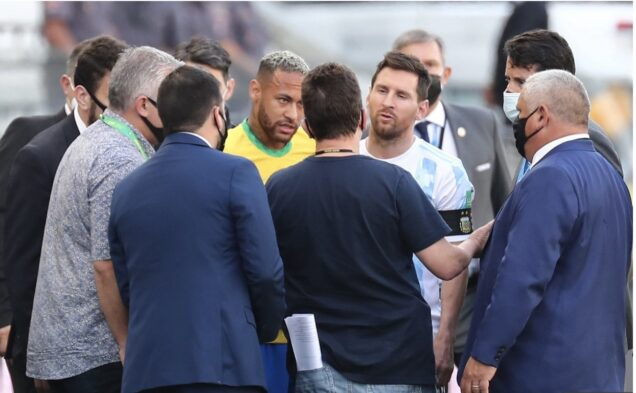 Neymar and Lionel Messi argue with the health officials after the match was stopped