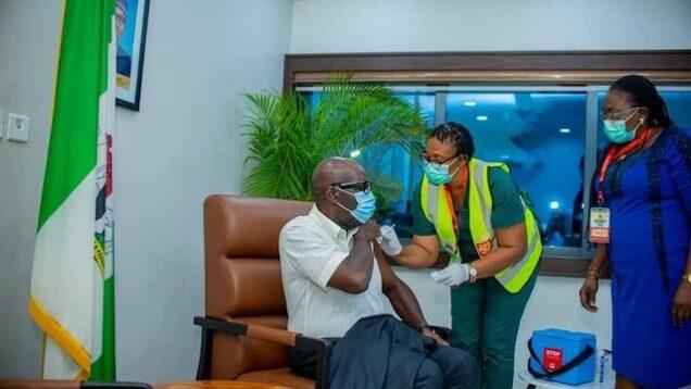 Obaseki taking the COVID-19 vaccination jab