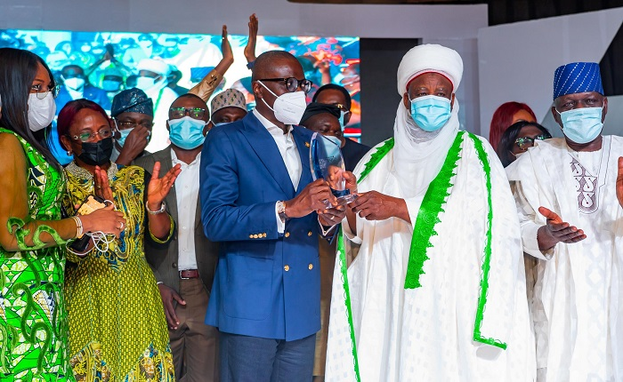 Lagos State Governor, Mr. Babajide Sanwo-Olu (middle), receiving 'Governor of the Year Award' from Sultan of Sokoto, Alhaji Muhammadu Sa'ad Abubakar III (second right), while the Special Adviser to the Governor on Works & Infrastructure, Mrs. Aramide Adeyoye (second left); Caretaker Chairman of APC Lagos, Alhaji Tunde Balogun and others applauds the presentation, during the 2020 Leadership Group Annual Conference and Awards, organized by Leadership Newspapers , at the International Conference Centre (ICC), Abuja, on Thursday, September 9, 2021.