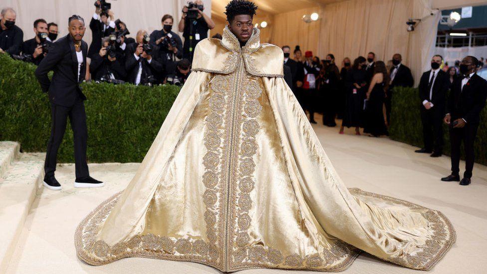 Rapper Lil Nas X first served up a regal robe...