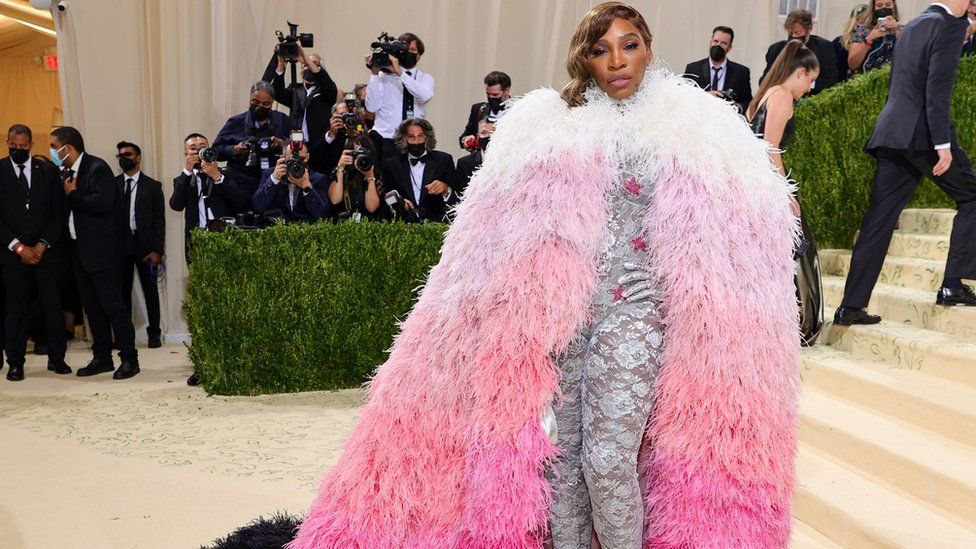 Serena Williams grabbed attention in a Gucci bodysuit beneath a floor-length feather cape