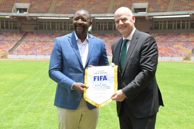 Sports minister Sunday Dare with Infantino at Moshood Abiola Stadium in Abuja