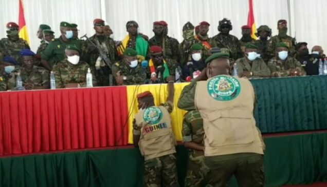 The Guinean coup leaders  at a meeting with ousted politicians on Monday