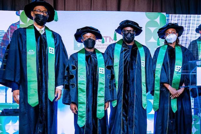 (l-r) Chairman NUTM Board Mr. Okey Enelamah, Vice President Yemi Osinbajo SAN, Mr. Adeyemi-Bero and Dr. Mobola Johnson at the Nigerian University of Technology and Management's Founding Class of 2021 Scholars Graduation Program in Lagos, Nigeria.
