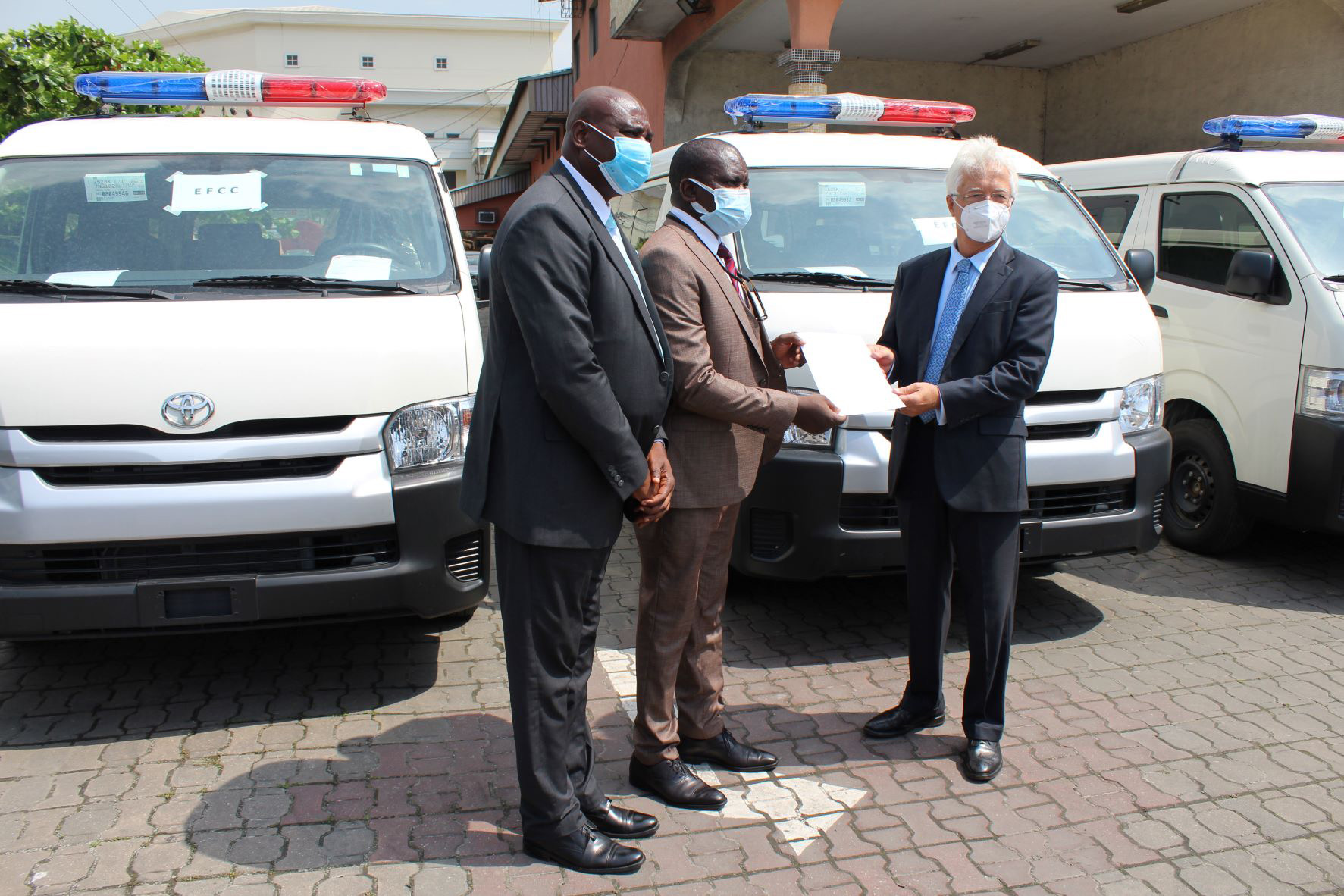 Officials of the Economic and Financial Crimes Commission receiving the donated vehicles from the Consul General of the Federal Republic of Germany in Lagos, Dr. Bernd von Munchow-Poh in Lagos