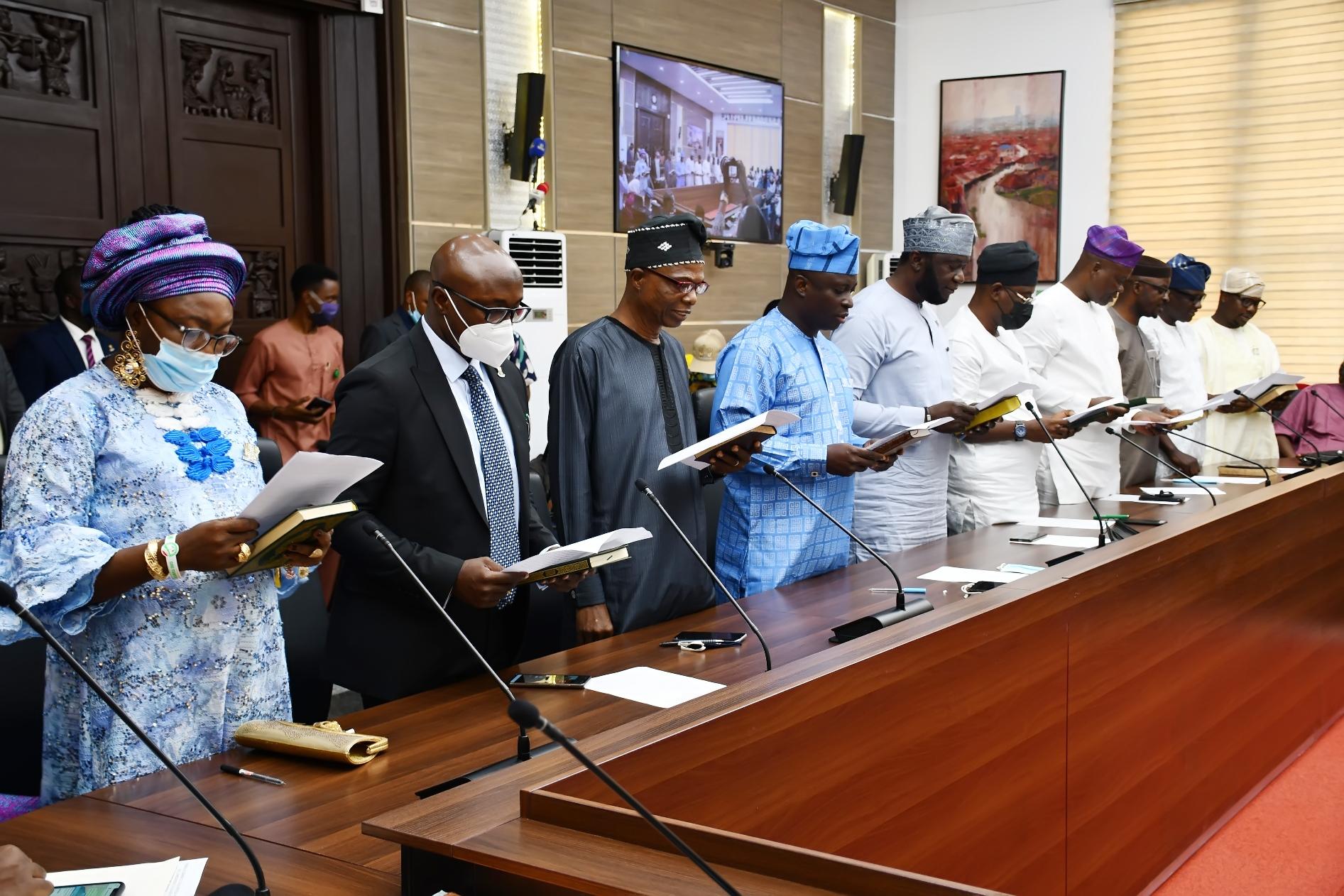 The Newly and re-appointed Commissioners, from left, Alhaja Kafilat Olayiwola; Dr Taiwo Ladipo; Mr Olusegun Olayiwola; Prof Musibau Babatunde; Mr Segun Oni; Barr. Abiodun Abdul-Raheem; Dr Wasiu Olatunbosun; Barr. Olasunkanmi Olaleye; Mr Adeniyi Adebisi and Seun Fakorede taking the oat during their swearing-in as Commissioners in Oyo State held at Governor's Office, Secretariat, Ibadan.