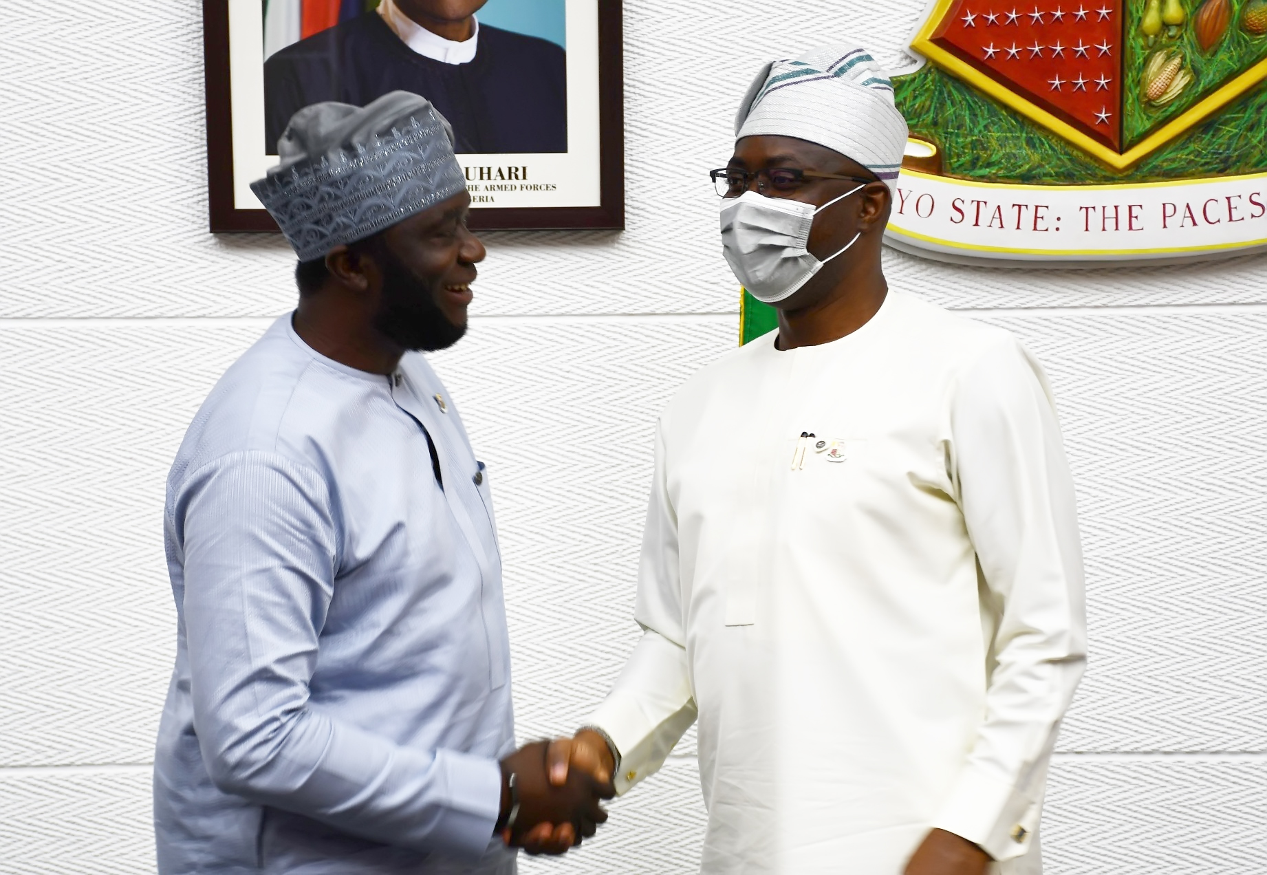Oyo State Governor, Seyi Makinde (right) and one of the newly appointed commissioners Mr Abiodun Oni during the swearing-in held at Governor's Office, Secretariat, Ibadan.