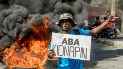 A man protests the latest kidnapping in Port au Prince on Saturday. Photo Haitian Times
