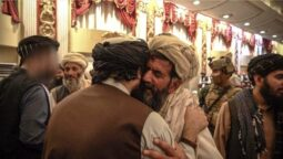 Sirajuddin Haqqani, face blurred, left meets one of the families of suicide bombers